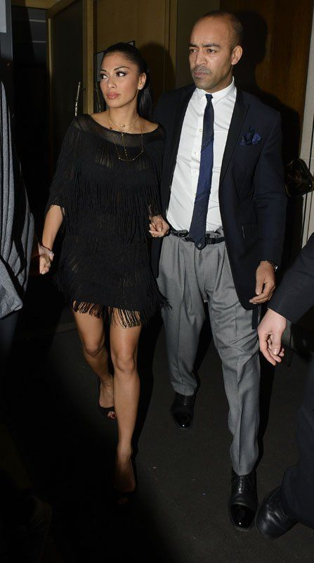 Nicole Scherzinger on a swanky evening in London looking very nice in a fringe 20s dress.