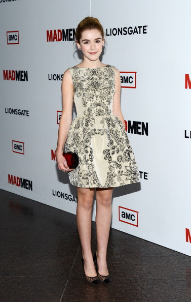 Actress Kiernan Shipka arrives at the Premiere of AMC's 'Mad Men' Season 6 at DGA Theater on March 20, 2013 in Los Angeles, California.The young actress look lovely in Red Valentino fall 2013 beige and black printed dress.