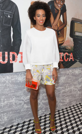 Solange Knowles wearing a Orange Lucite Clutch March 24 2013