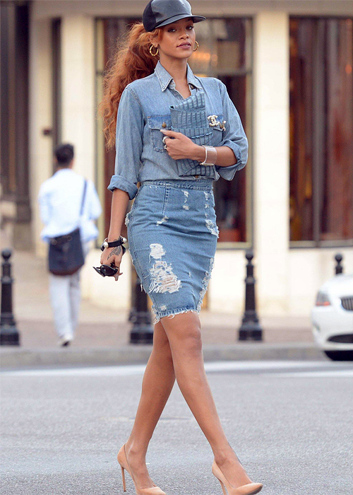 Rihanna out & about wearing a denim combo outfit with a big Chanel Brooch.