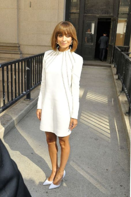Nicole Richie, wearing a sixties inspired white dress and heels, heads out to the AOL 2013 Digital Contest NewFront in New York City.