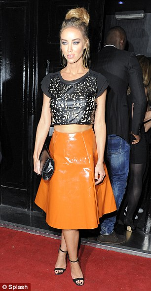 Stepping out Lauren Pope on her way to the Club in London wearing a orange PVC skirt