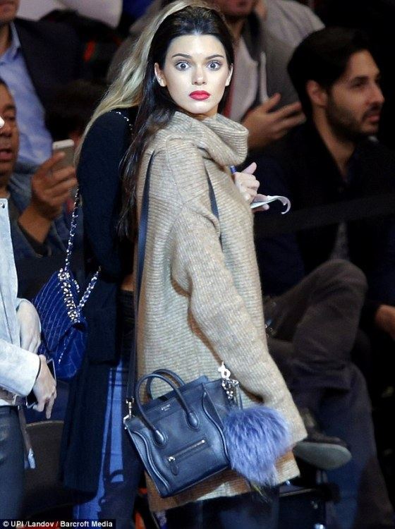 Kendall Jennerlooks amazing while watching basketball with fellow models Gigi Hadid and Hailey Baldwin in New York City.  Read more: http://www.dailymail.co.uk/tvshowbiz/article-2804404/Kendall-Jenner-steals-spotlight-watching-basketball-fellow-models-Gigi-Hadid-Hailey-Baldwin-New-York-
